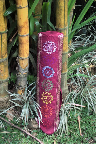 Yoga Mat Bag with Chakra embroidery in Maroon has elephant trim in gold. Zip closure with adjustable length strap.