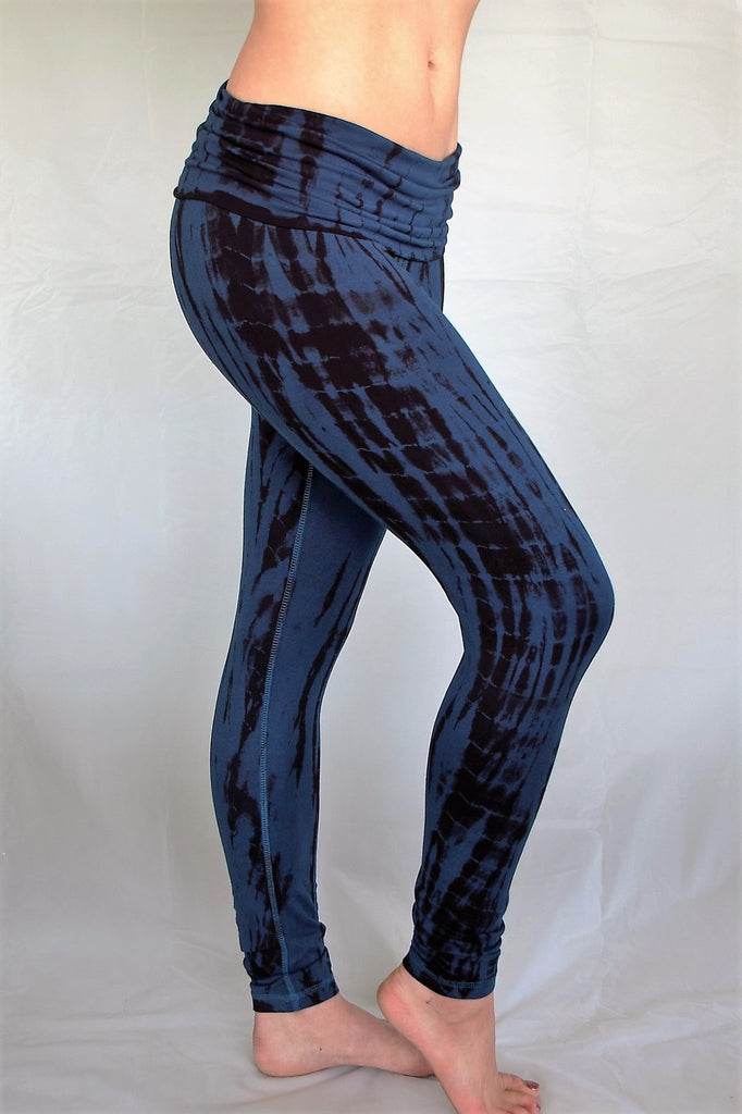 Midnight tie dye, blue with black long length yoga pants with fold over top for adjustable fit can be worn with higher waist or lower on the hips. Soft, comfortable 90% cotton 10% spandex.