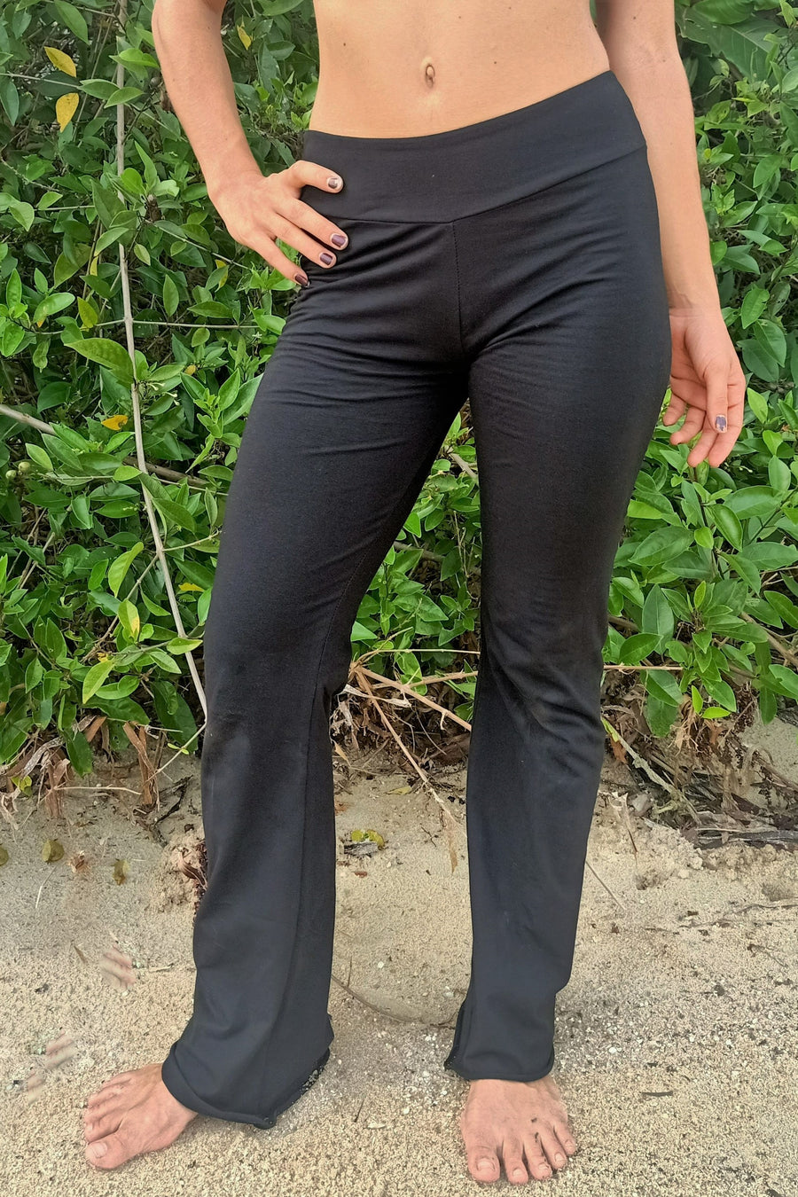 Front view of Flared bottom Yoga Pants in solid black Onyx with flat waist band by Lotus Tribe Clothing