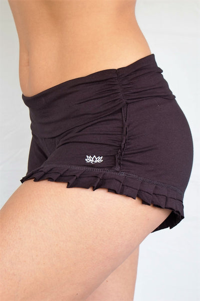 Soft, black short shorts with ruffles at bottom and fold over waist perfect for hot yoga or paired with your favorite top, also great for under a short dress.