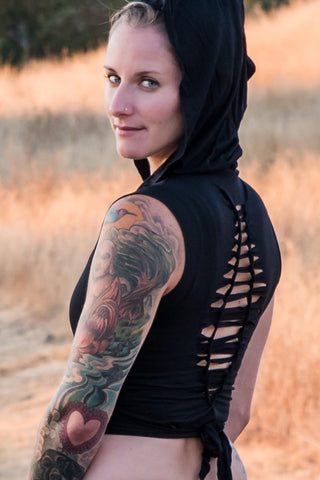 Sleeveless Onyx Ninja Jacket Wraps come with oversized hood and see thru detail on back. Soft and silky, perfect for layering over a sportbra after yoga class or as streetwear