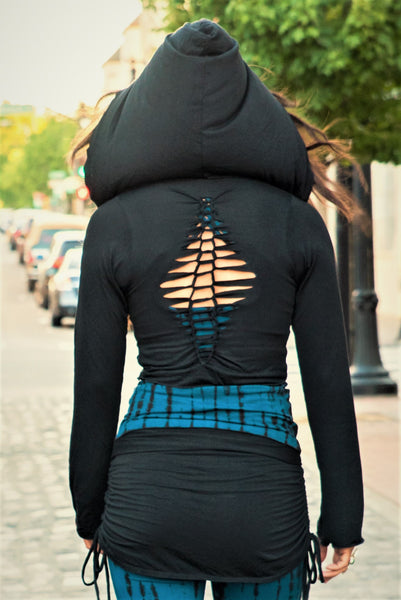 Back view of Long Sleeve Onyx Ninja Jacket Wrap. Comes with oversized hood and see thru detail on back. Soft and silky, perfect for layering over a sportbra after yoga class or as streetwear