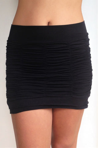 SStretchy, flattering & comfortable black mini skirt with ruffled scrunchy look. Form fits to any body shape, great for the curvy girls!  90% cotton knit 10% spandex