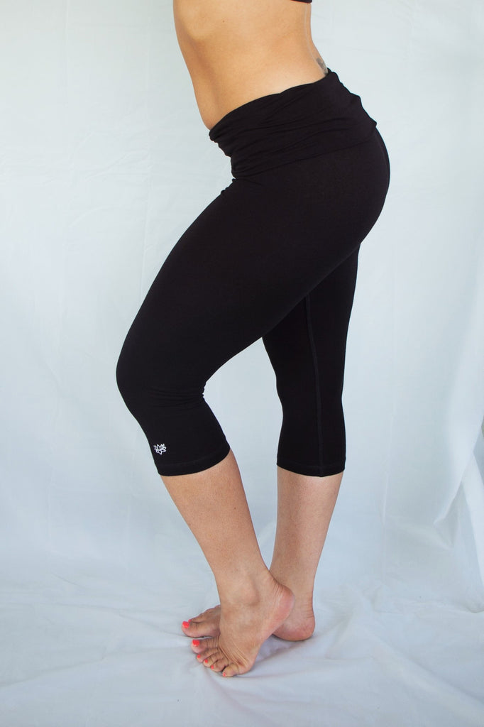 Solid colored black 3/4 length Yoga Pants have a fold over waist that is adjustable to fit a longer torso or be worn lower on the hips. Soft 90% cotton and 10% spandex.