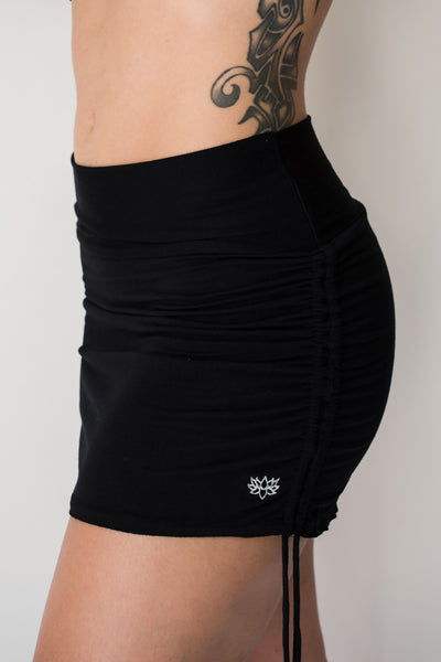 Cute little black mini skirt with pull strings on the sides and fold over waist for adjustable fit. Soft and comfortable 90% rayon 10% cotton. Fits small/medium