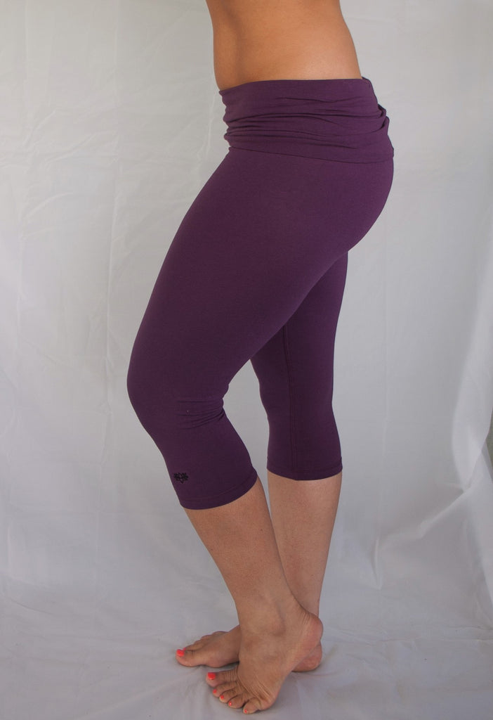 e89d06ef55 Solid colored plum 3/4 length Yoga Pants have a fold over waist that is
