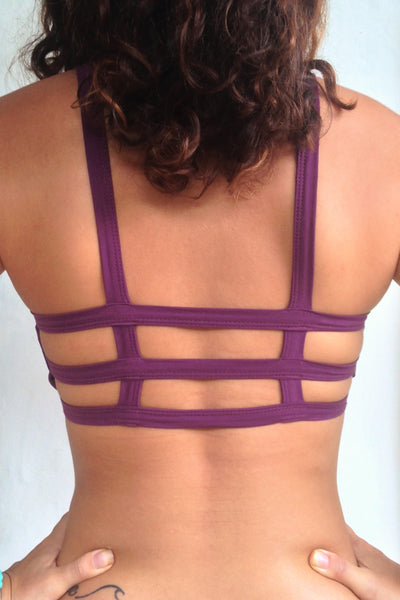 Back view of Plum Trinity Sportsbra showing 3 horizontal straps across back  One of the most comfortable sports bras you will ever wear, soft and super cute. Solid purple front 90% cotton 10% spandex