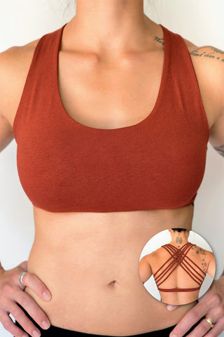Rust sports bra with 4 criss cross straps on back with enough support for down dog and other yoga poses, or whatever sports you enjoy. 90% cotton 10% spandex