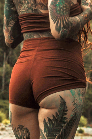 High waist Yoga Shorts in Rust by Lotus Tribe Clothing. Made from 90% cotton with 10% spandex they are super soft booty hugging short shorts.
