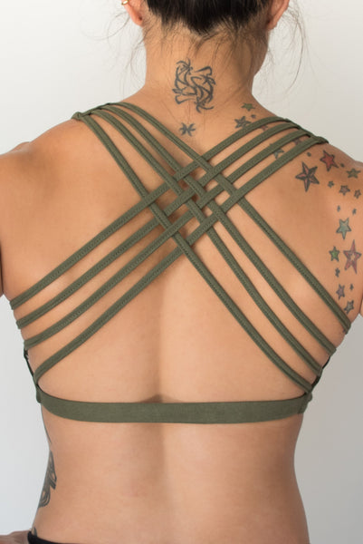 Sage sports bra with silver bodhi tree design on front, has 4 criss cross straps on back with enough support for down dog or other yoga poses.