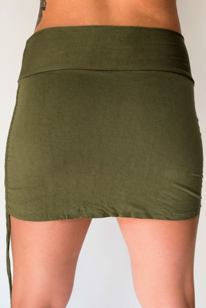 Cute little sage green mini skirt with pull strings on the sides and fold over waist for adjustable fit. Soft and comfortable 90% rayon 10% cotton. Fits Sm/Med
