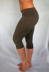 Solid colored sage green 3/4 length Yoga Pants have a fold over waist that is adjustable to fit a longer torso or be worn lower on the hips. Soft 90% cotton and 10% spandex.