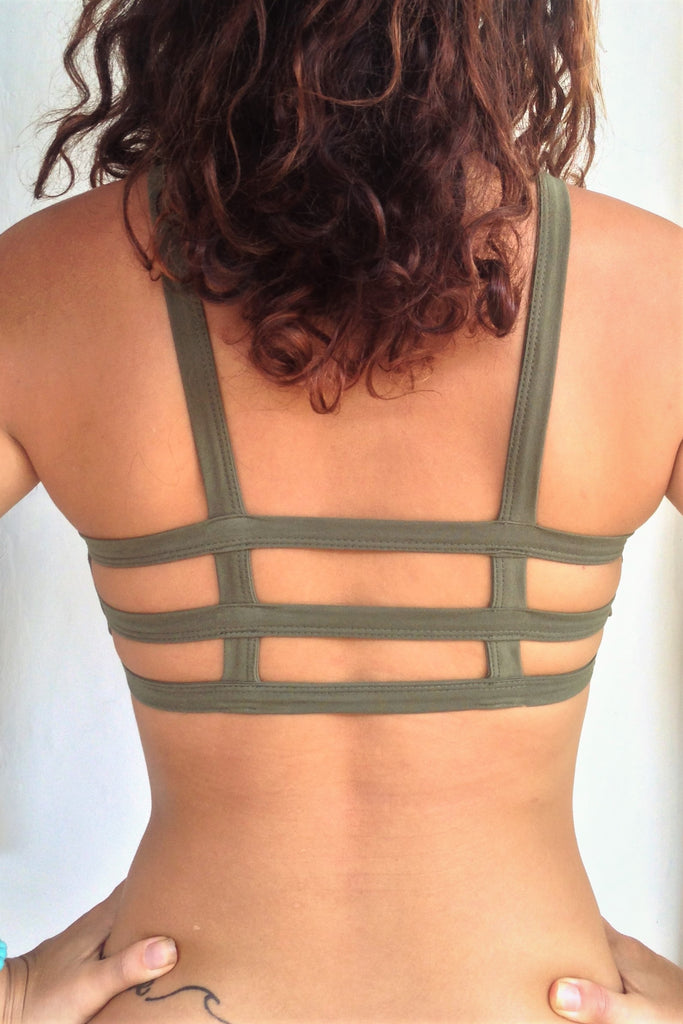 Back view of Trinity Sportsbra shows with 3 horizontal straps across back. Bra has solid Sage green front. One of the most comfortable sports bras you will ever wear, soft and super cute . Medium support.