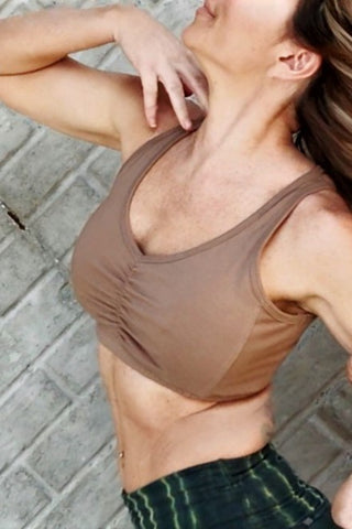 Sand (beige) Sunburst SportsBra with center scrunching between the breasts. Full coverage, no side boob.  Fits larger chested active women especially while still being soft, cute, comfortable and functional.