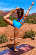 Woman in standing yoga pose wearing Sky blue Yoga Shorts and matching Trinity Bra by Lotus Tribe Clothing
