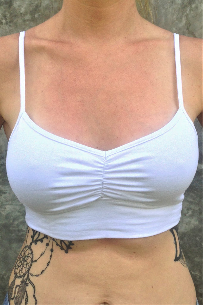 Front view of flattering white bra with adjustable spaghetti straps and ruched center puckering.