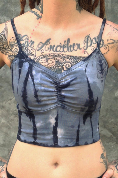 Front view of Sodalite tie dye Blissed Out crop tank with adjustable spaghetti straps and scrunched center puckering between the breasts. Steel blue with black streaks and white highlights.