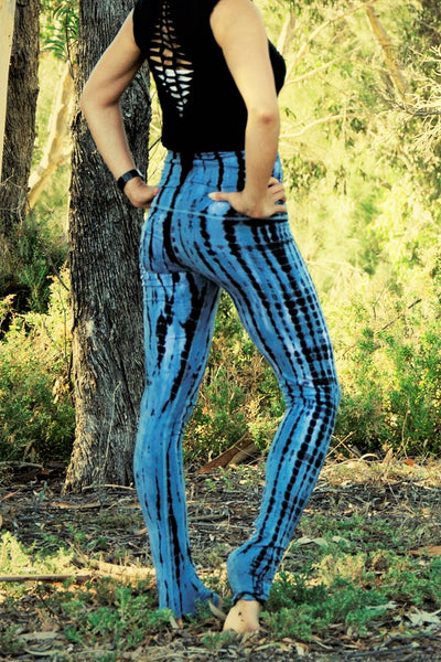 Long yoga pants tie dyed steel blue with black. Fold over top for adjustable fit can be worn with higher waist or lower on the hips. 90% cotton 10% spandex.
