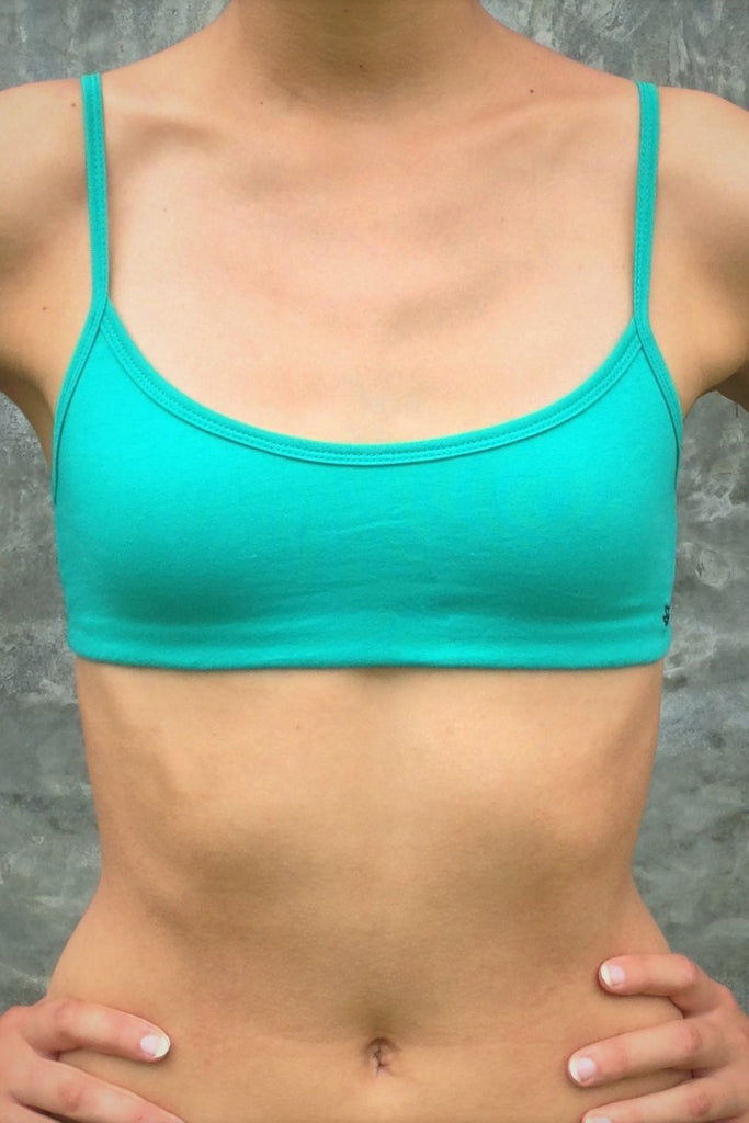 asic, minimalist sports bra with adjustable spaghetti straps in vibrant turquoise color with medium support, great for an active lifestyle.