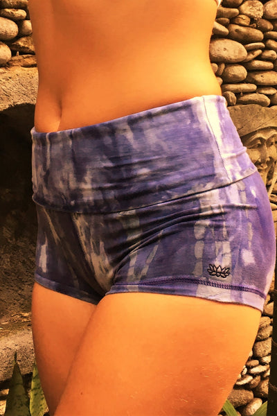 Comfortable, flattering high quality 90% Organic Cotton with 10% spandex knit into soft stretchy yoga shorts with fold over top for adjustable fit can be worn with higher waist or lower on the hips. Gorgeous cool purple hues with grey and possibly white highlights and small lotus flower embroidery on side.
