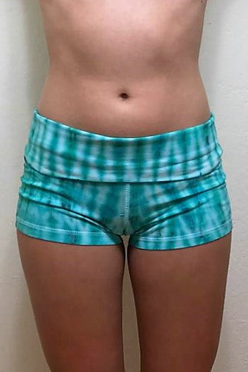 Beautiful aqua marine and turquoise with white highlights. Soft and comfortable tie dyed short shorts with fold over waist for adjustable custom fit, can be worn higher waisted, or low on the hips. Perfect for the gym, yoga, pole, etc.