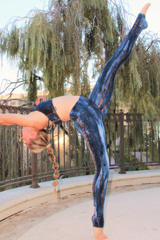Blue tie dye with brown streaks and white highlights on fold top yoga pants made from 90% organic cotton and 10% spandex.