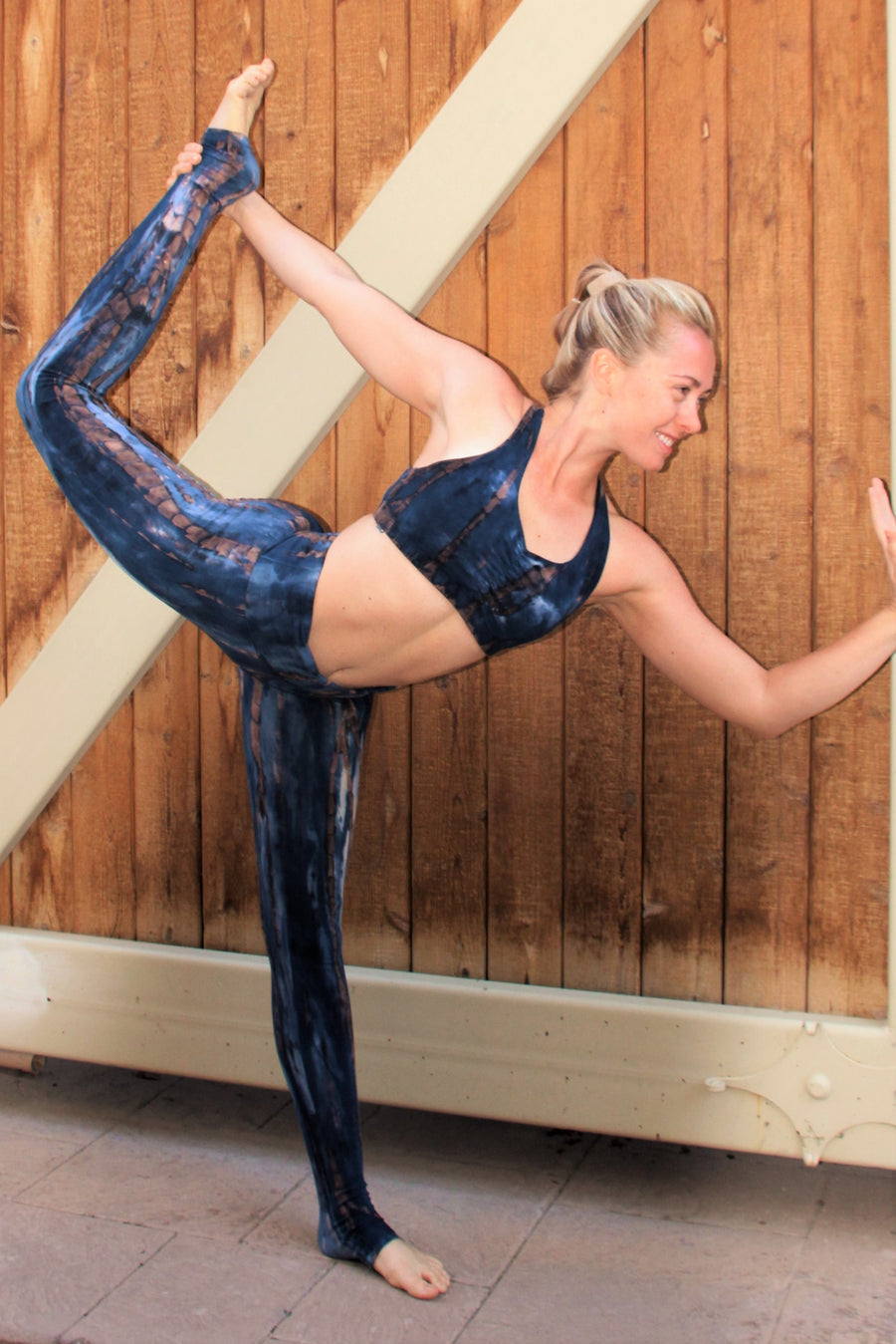 Indigo Earth tie dye outfit, one yoga pants and one Shakti Sports Bra in deep dark blue tie dyed with brown streaks and white highlights.