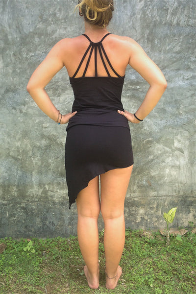 Back view of black Onyx Tank Top with beautiful back strap design pictured with our asymmetrical Festival Skirt.