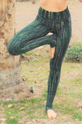Fold top yoga pants in gorgeous earthy green tones with beige highlights made of organic cotton.