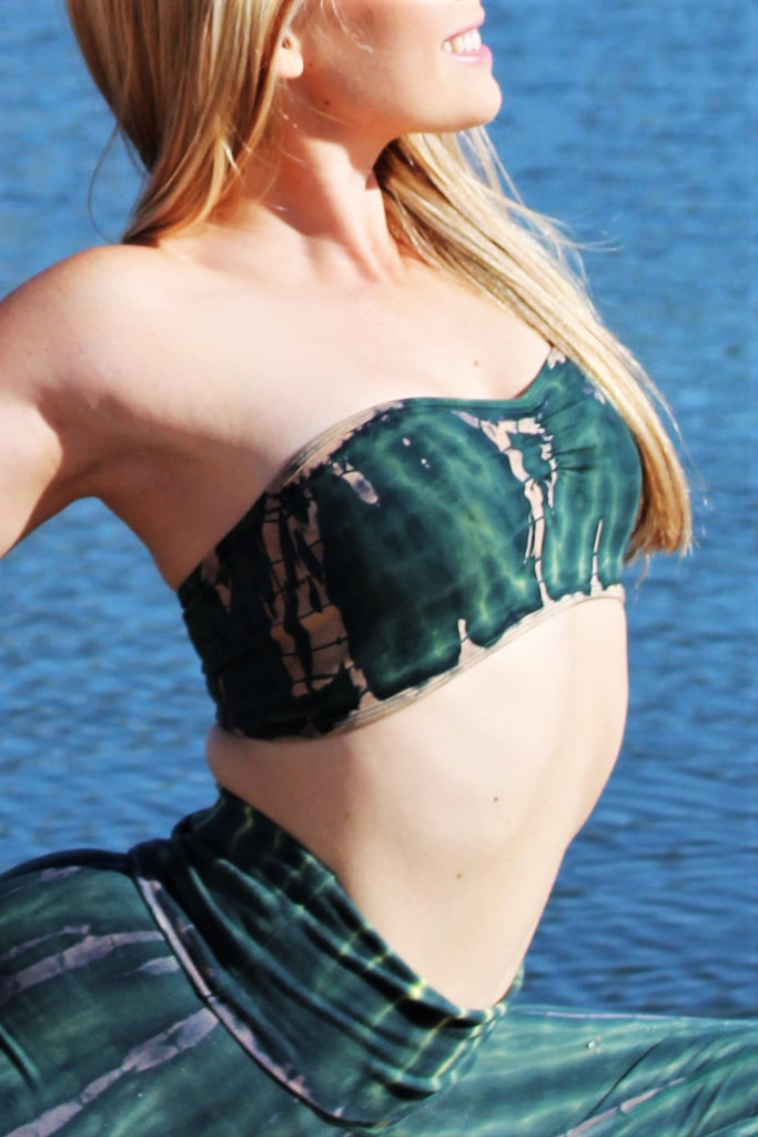 Side view of strapless Bandeau Top with center scruching between the breasts in Rainforest tie dye, deep green hues with beige streaks and yellow highlights. 90% Organic Cotton with 10% Spandex