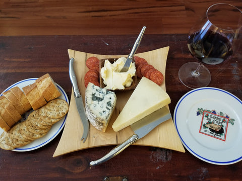Assortment of cheeses, crackers and wine