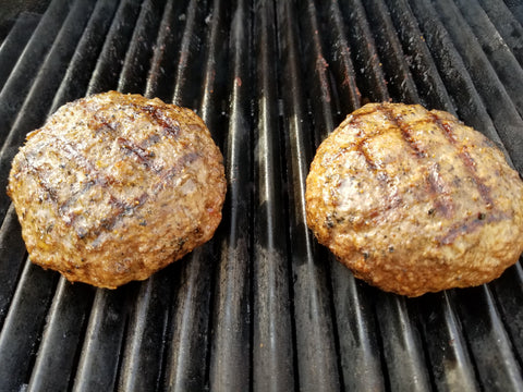 two burgers on the grill