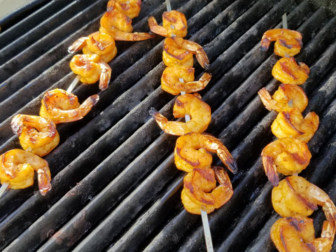 skewered shrimp on the grill