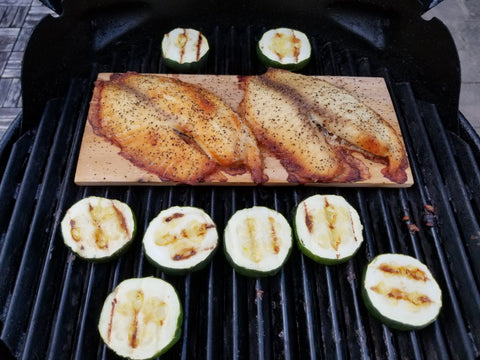 Fish and zucchini on a grill