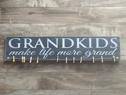 "Grandkids make life more grand 5""x 24"" - MDF with 12 pegs"