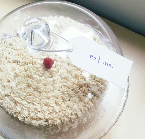 "The finished Raspberry Earl Grey Cake with an ""eat me"" tag."