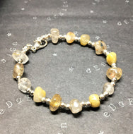 Beaded bracelet - silver with rutilated copper quartz beads