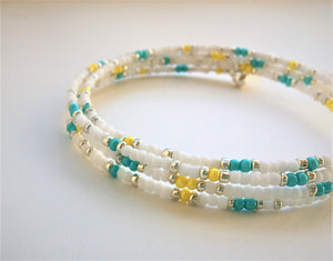 Beaded memory wire bracelet - white, turquoise, yellow and silver beads with angel wing pendant