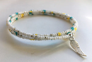 Beaded memory wire bracelet - white, turquoise, yellow and silver beads with angel wing pendant - eDgE dEsiGn London