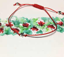 Single strand red cord bracelet with silver stars - adjustable sliding knot fastening