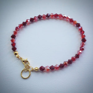 Stylish Swarovski crystal bracelet - shades of red with gold plated adjustable clasp - eDgE dEsiGn London