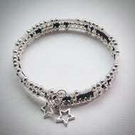 Beaded memory wire bracelet - black, white and silver beads with stars - eDgE dEsiGn London