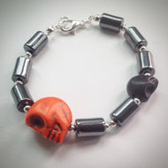 Beaded bracelet - Hematite and silver with orange and black skulls - eDgE dEsiGn London
