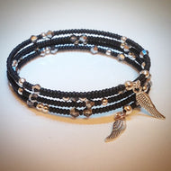 Beaded memory wire bracelet - black with silver and Swarovski crystals and wing pendants - eDgE dEsiGn London