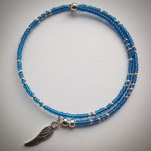 Beaded memory wire bracelet - blue glass and silver seed beads, silver plated wing pendant - eDgE dEsiGn London