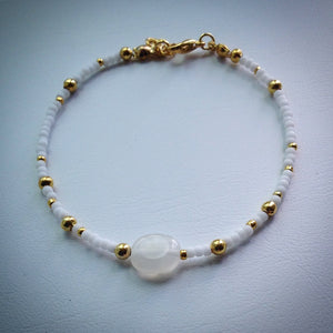 Beaded bracelet - white and gold seed beads and oval clear quartz bead - eDgE dEsiGn London