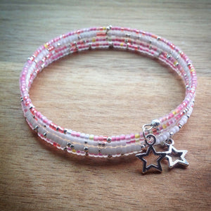 Beaded memory wire bracelet - white, pink, yellow and silver seed beads and silver star pendants - eDgE dEsiGn London