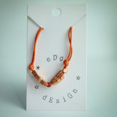 Adjustable sliding knot bracelet - Orange with Gold beads - eDgE dEsiGn London