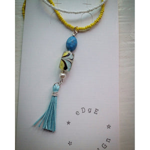 Long white/yellow beaded necklace with pendant - eDgE dEsiGn London