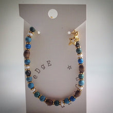 Beaded bracelet - Turquoise ceramic, wood and white beads with gold star pendant - eDgE dEsiGn London